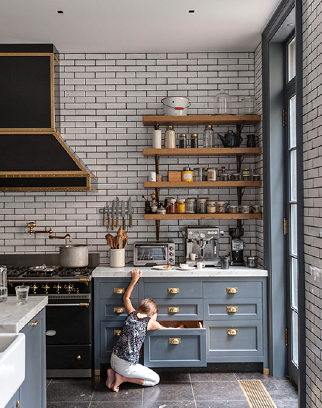 beautiful grey kitchen with gold accents and subway tile